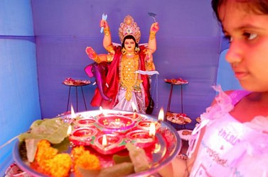 A girl praying to Bishwakarma at Gurkabasti in Agartala. TIWN Pic Sept 17