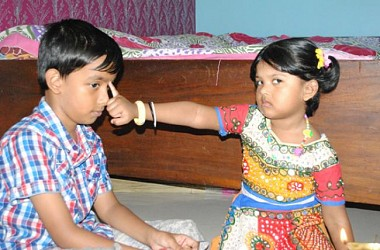 A sister offering Bhai Phota to her brother in Agartala. TIWN Pic Oct 24