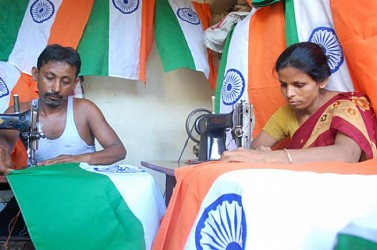 Tailors busy in making National flag for Independence Day. TIWN Pic July27