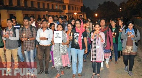 Students of Tripura University participated in a candle march for Shahid Hanumanthappa. TIWN Pic Feb 11