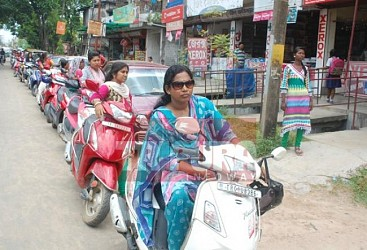 Women stands in queue for petrol at Ganaraj Chowmuhani. TIWN Pic July 27