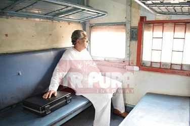 CM travelling in train to reach Kumarghat. TIWN Pic April 28