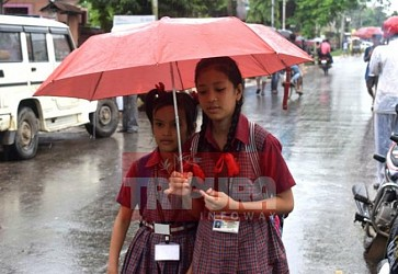 Students facing hardtimes due to constant rain at Agartala. TIWN Pic July 26