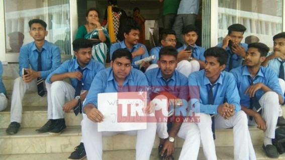 Nursing College Students sit in demonstration at Tripura University demanding results, registration numbers