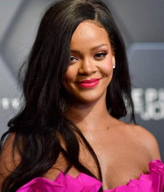 Rihanna sues her father