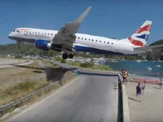 Plane lands few feet away from tourists, video goes viral
