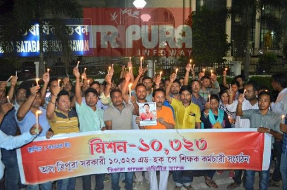 10323 Teachers held candle march rally for died Teacher Surajit Debbarma, blamed State Govt for his death, warned public not to insult 10323 teachers