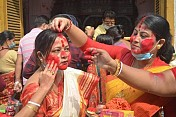 Women celebrate Bijoya Dasami's Sindoor Khela without-masks in Durga Bari
